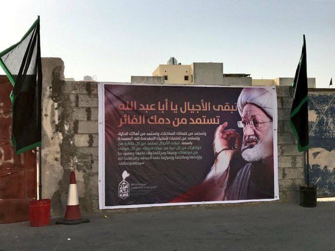 Images of Jurist Qasim and his words are showing during Ashura ceremonies