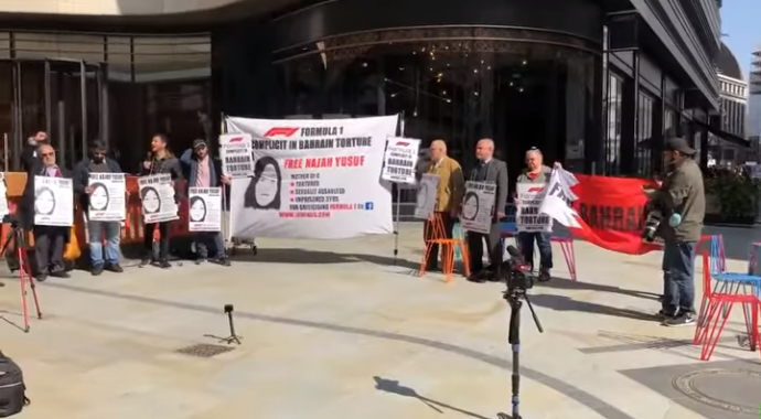 Activists hold a protest outside Formula. 1 building in London